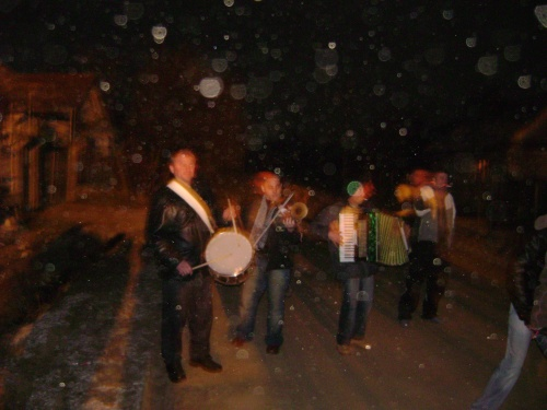 Young boys late at night start to go from house to house to sing carols and differit songs. They are accompanied by three players. Romania