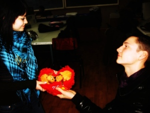 Dani gives a pillow like heart to his girlfriend.