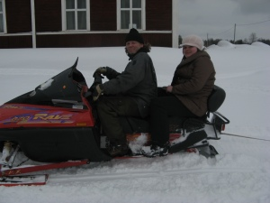Monica (Romania) on the snowmobile in Burträsk, Sweden